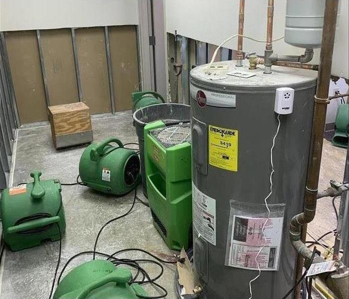 Air movers and dehumidifiers placed in a damaged area