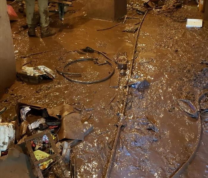 Mud affected this entire basement from the stream overflowing due to the huge rain storm we had in our area.